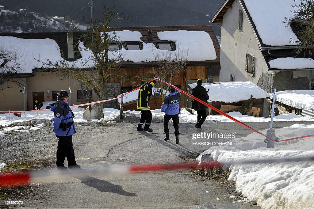 Police search evidences on January 3, 2013 in Daillon after a gunman has opened fire in a village in southern Switzerland, killing three people and wounding two others on the eve. The man, who had reportedly been drinking heavily before the shooting and was armed with an assault rifle, launched the attack in the village of Daillon late on January 2, 2013.