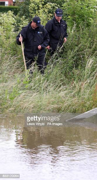 Police search for a reported missing man as flood waters rise in Toll Bar near Doncaster South Yorkshire