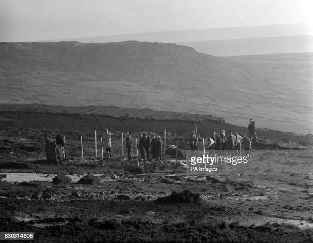 Police search for human remains on Saddleworth Moor near AshtonunderLyne In the centre of the group is Mr Eric Cunningham chief of the North West...