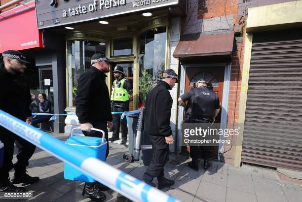 A police search team enters a flat above Shiraz Restaurant in Hagley Road Birmingham which was raided by antiterror police in connection with the...