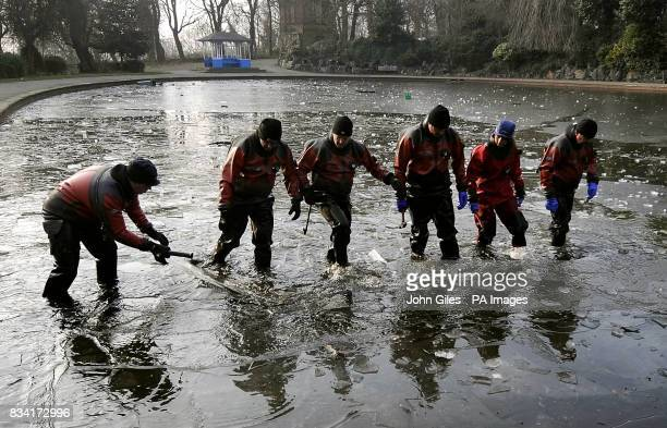 Police search teams break the ice to search the lake in a park close to the home of nineyearold Shannon Matthews who went missing from her home in...