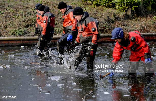 Police search teams break the ice to search the lake in a park close to the home of nine year old Shannon Matthews who went missing from her home in...