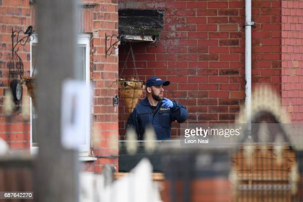 Police search teams work at the former home of terrorist Salman Abedi on May 24 2017 in Manchester England An explosion occurred at Manchester Arena...