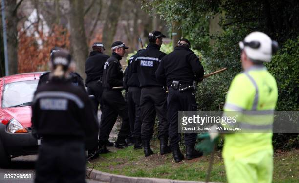 Police search the area around the house in Handsworth Wood Birmingham where the bodies of Avtar and Carole Kolar were discovered this morning...