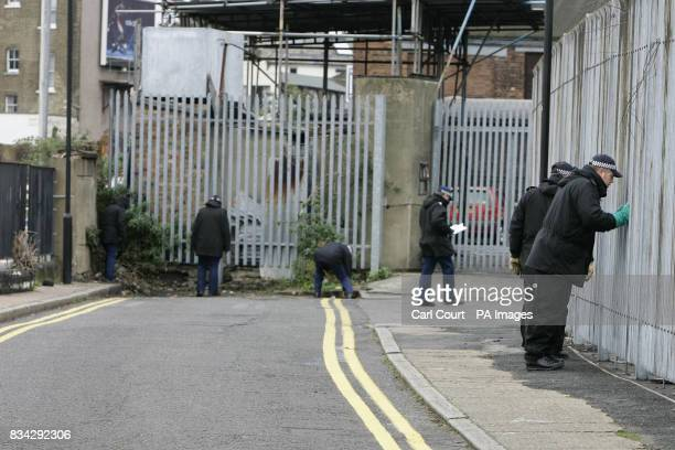 Police search the area near to the Matalan store in the Kingsland Centre Dalston east London where 33 year old Jamie Simpson an assistant manager was...