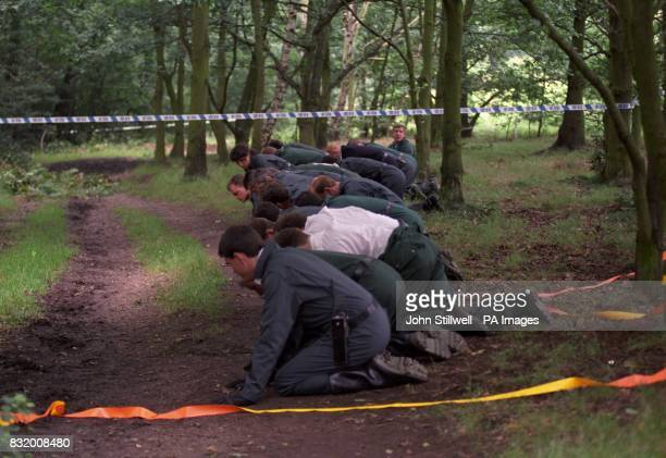 Police search the floor of the woods in Wimbledon Common where the body of young mother Rachel Nickell was found