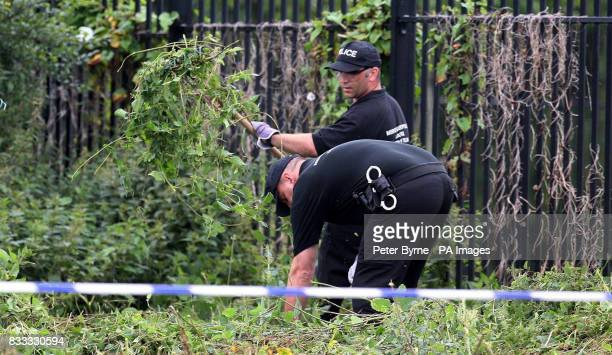 Police search the scene behind the Fir Tree pub in Croxteth Liverpool after 11yearold Rhys Jones was shot dead on Wednesday night
