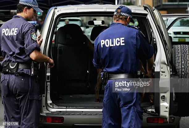 Police search vehicles as part of security for US Secretary of State Condoleezza Rice on March 16 2006 in Sydney Australia Dr Rice is in Australia to...