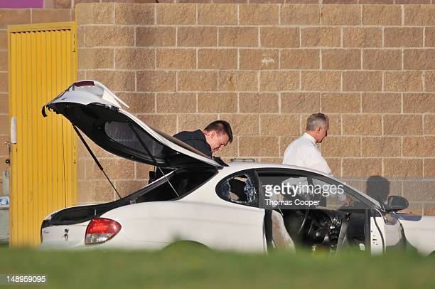 Police search what is believed to be the car of James Holmes the suspect of a shooting in a movie theater outside the Century 16 movie theater July...