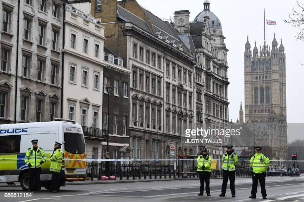 Police secure a cordon blocking access to the Houses of Parliament in central London March 23 2017 the day after the March 22 terror attack Britain's...