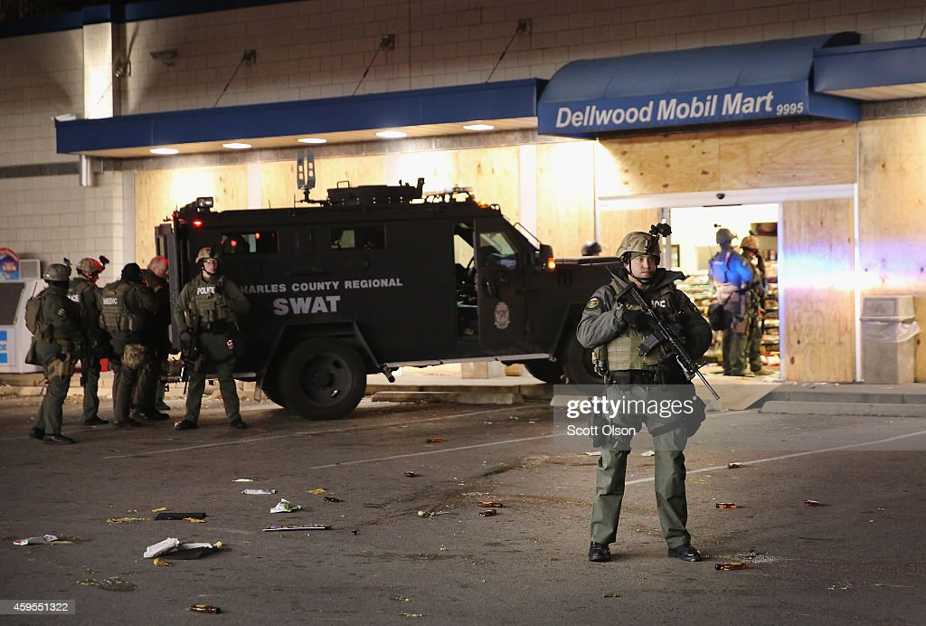 Police secure a gas station that was being ransacked by looters during rioting which broke out following the grand jury announcement in the Michael Brown case on November 24, 2014 in Ferguson, Missouri. Ferguson has been struggling to return to normal after Brown, an 18-year-old black man, was killed by Darren Wilson, a white Ferguson police officer, on August 9. His death has sparked months of sometimes violent protests in Ferguson. A grand jury today declined to indict officer Wilson.