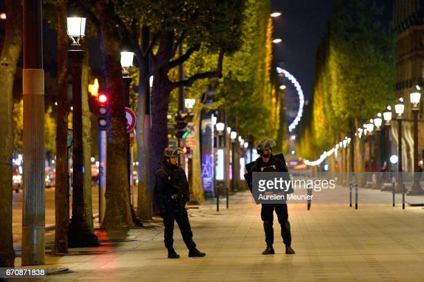 Police secure the area after a gunman opened fire on the Champs Elysees on April 20 2017 in Paris France One police officer was killed and another...
