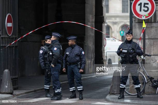 Police secure the area in front of the Louvre on February 3 2017 in Paris France A French soldier opened fire on a man who alledgely attacked a...