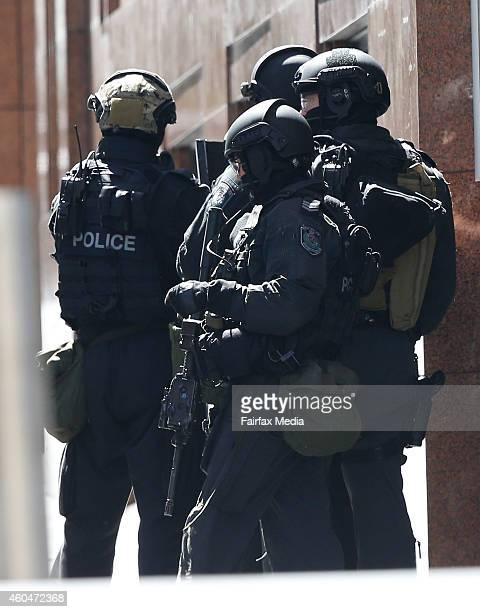Police secure the area near Lindt Chocolate Café in Martin Place on December 15 2014 in Sydney Australia Major landmarks in Sydney including the...