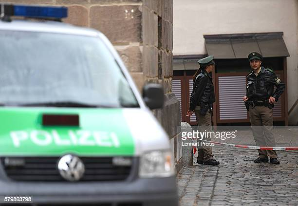 Police secure the area of a suicide bomb attack at a music festival on July 25 2016 in Ansbach Germany According to police a 27yearold Syrian who had...