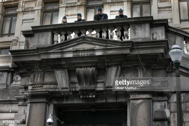 Police secure the courthouse while former ministerpresident of Catalonia Carles Puigdemont and members of his regional government appear in front of...