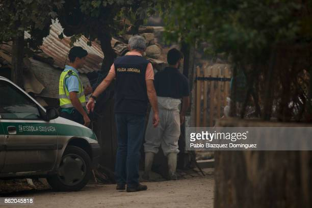 Police secure the entrance to a house where allegedly three people died in the village of Vila Nova near Vouzela on October 16 2017 in Viseu region...