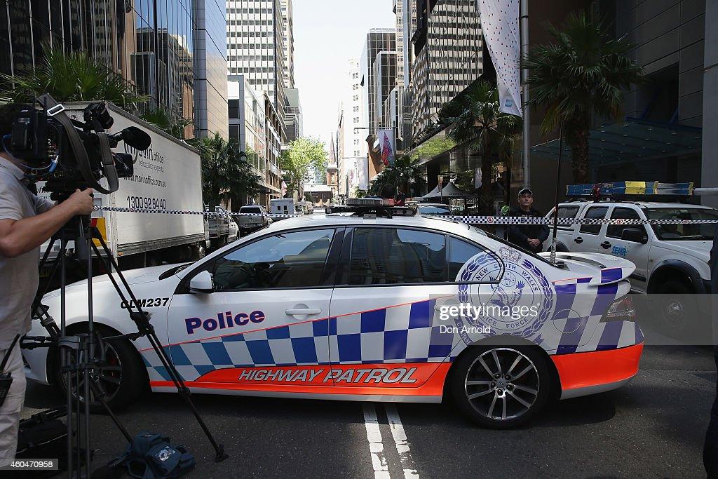 Police secure the scene near Lindt Cafe Martin Place on December 15 2014 in Sydney Australia Major landmarks in Sydney including the Sydeny Opera...
