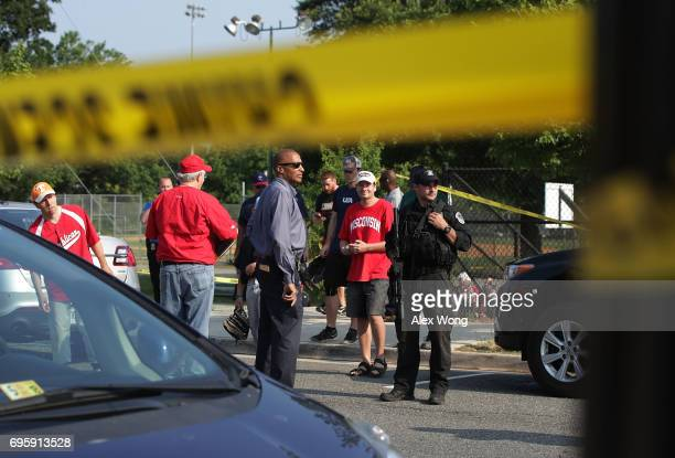 Police secure the site of a morning shooting as US Rep Chuck Fleischmann looks on at Eugene Simpson Stadium Park June 14 2017 in Alexandria Virginia...