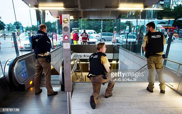 Police secures the entrance to a subway station near a shopping mall where a shooting took place on July 22 2016 in Munich Several people were killed...