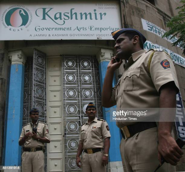Police security outside kashmir Emporium after protest by Hindu organizations over controversy steered by seperatists in Kashmir over Land for...