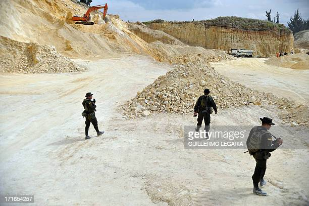 Police seize a gravel sand and stone quarry in the municipality of Soacha outskirts of Bogota on June 27 2013 In a joint PoliceJustice...