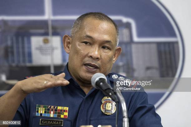 Police Senior Superintendent Romeo Caramat gestures during a press conference at the Philippine National Police headquarters in Manila on August 16...