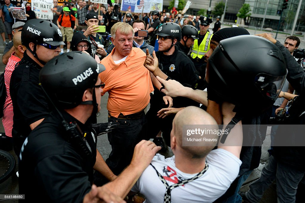 Police separate anti-Trump and pro-Trump supporters after a fight outside the Western Conservative Summit on July 1, 2016.