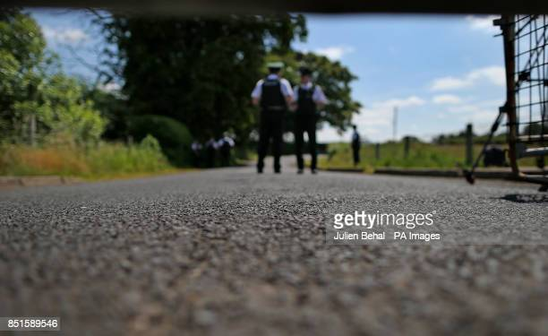 Police Service of Northern Ireland officers beyond the temporary barricade on Drumcree road on Sunday morning 7th July outside Portadown CoArmagh The...
