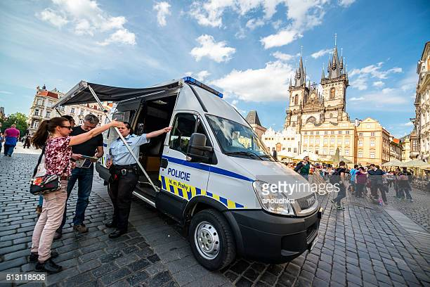 Police showing directions to tourists in Prague