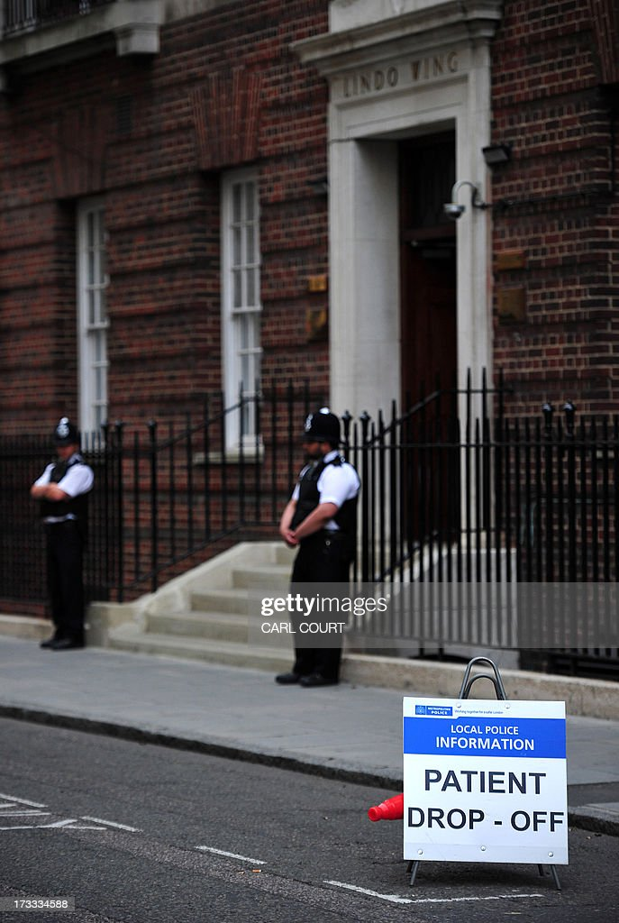 A police sign is placed outside the Lindo Wing of Saint Mary's Hospital in London, on July 12, 2013. Prince William and his wife Catherine's baby, which will be third in line to the throne, will be born in the private Lindo wing of St Mary's Hospital, where William was born in 1982 and his brother Harry in 1984.