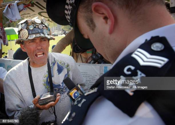 Police speak to Parliament Square demonstrator and longtime protestor againster the Iraq War Brian Haw outside the House of Commons in London