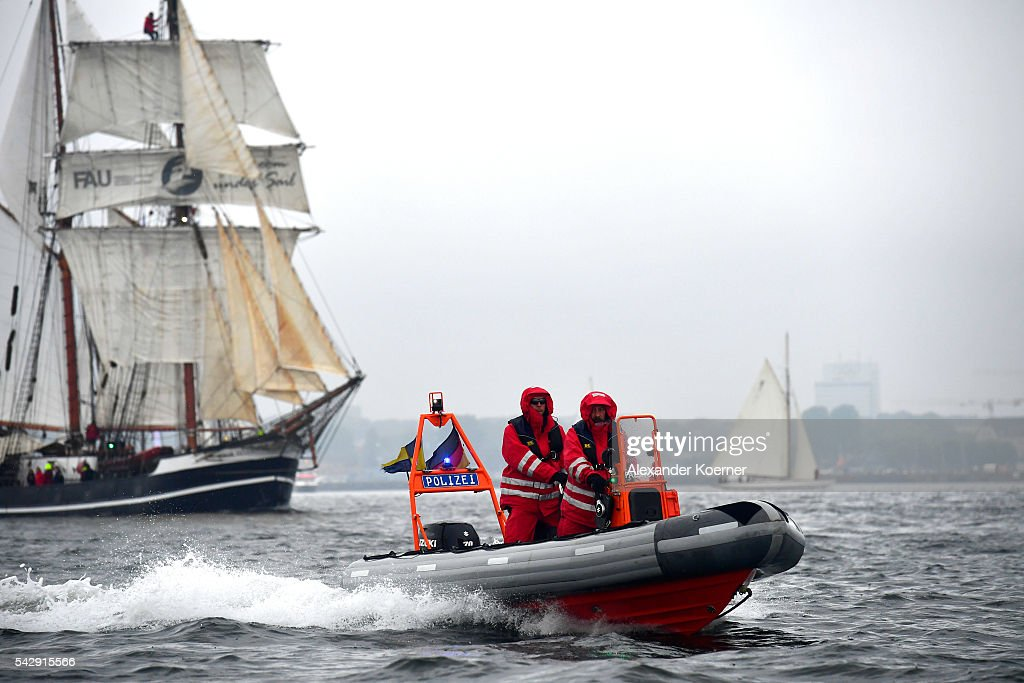A police speedboat passes the sailing ship 'Thor Heyerdahl' while sailing out of the Bay of Kiel during the annual Windjammer parade on June 25, 2016 in Kiel, Germany. The annual Tall Ships Parade, in which many of the world's largest traditional sailing ships participate, is the highlight of the Kieler Woche (Kiel Week), the world's biggest regatta and sailing event.