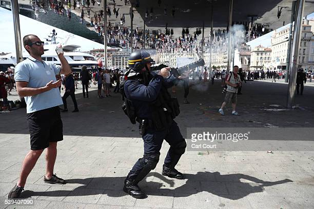 Police spray tear gas as England fans clash ahead of the game against Russia later today on June 11 2016 in Marseille France Football fans from...