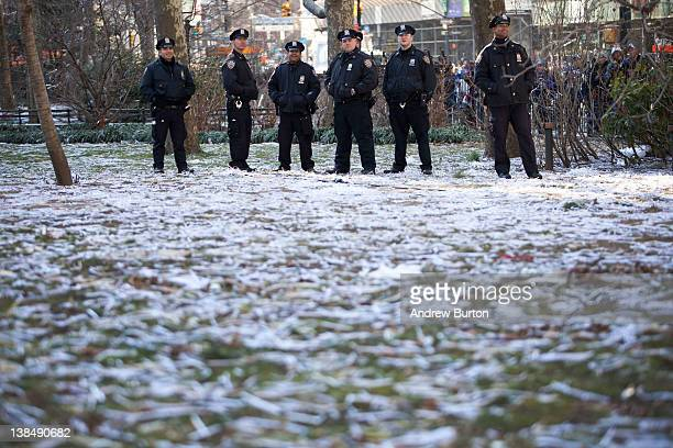Police stand amongst a field of ticker tape during The New York Giants' Victory Ceremony at City Hall on February 7 20122012 in New York City The...
