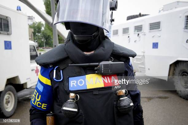 EU police stand at a main bridge during a protest in the divided town of Mitrovica on May 30 2010NATO peacekeepers and Kosovo riot police Sunday...