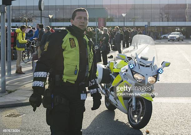 Police stand at Kastrup airport in Copenhagen on November 18 2015 Danish police evacuated one of two terminals at Copenhagen's Kastrup Airport...