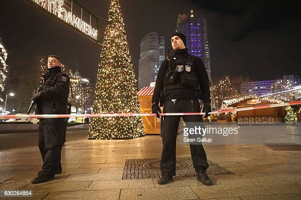 Police stand at the area after a lorry truck ploughed through a Christmas market on December 19 2016 in Berlin Germany Several people have died while...