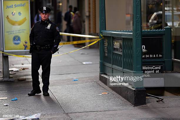 Police stand at the scene of a midtown shooting that left one dead with two others wounded on November 9 2015 in New York City A 43yearold man was...