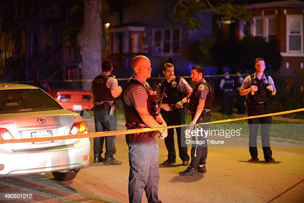 Police stand at the scene where multiple people were shot including a pregnant mother and grandmother on the 5300 block of South Aberdeen on Sept 28...