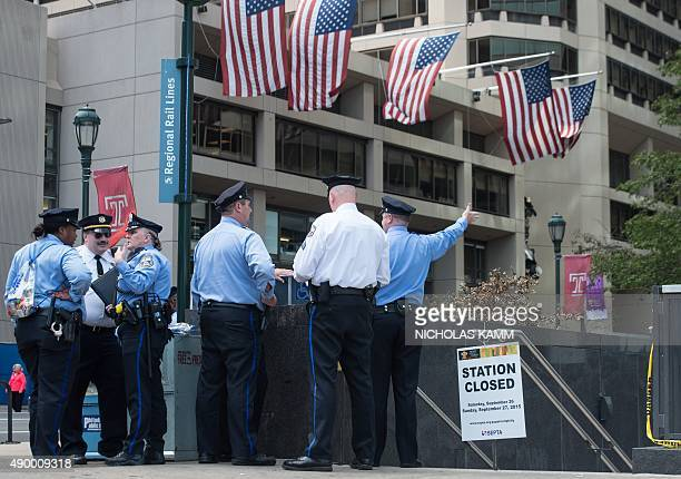Police stand by a closed subway station in Philadelphia on September 25 2015 on the eve of the arrival of Pope Francis The pontiff is on a sixday...