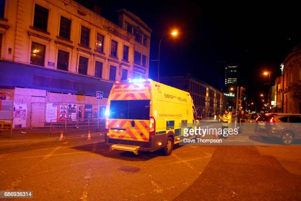 Police stand by a cordoned off street close to the Manchester Arena on May 22 2017 in Manchester England There have been reports of explosions at...