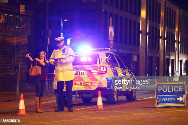 Police stand by a cordoned off street close to the Manchester Arena on May 22 2017 in Manchester England An explosion occurred at Manchester Arena as...