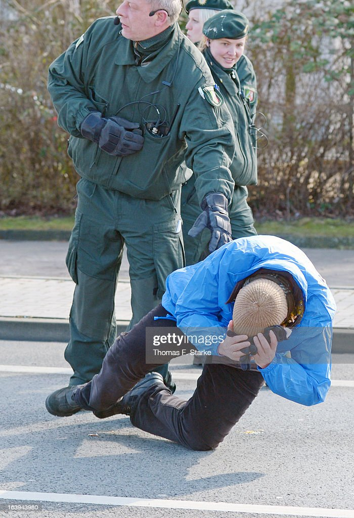 Police stand by as Joerg Ueckermann, Deputy Chairman of the anti-Islam Pro-NRW group, is tumbling after a protester hit him in the face with an egg while Ueckermann was speaking during a Pro-NRW rally on March 18, 2013 in Bielefeld, Germany. Nine Pro-NRW members held the rally and were booed down by 700 counter-demonstrators. Pro-NRW, based primarily in western Germany and Berlin, has sought a strongly anti-Islam agenda and demonstrates frequently against the construction of mosques in Germany. Police recently arrested several radical Salafite Islam members in Germany who were planning to assassinate Pro-NRW leader Markus Beisicht.