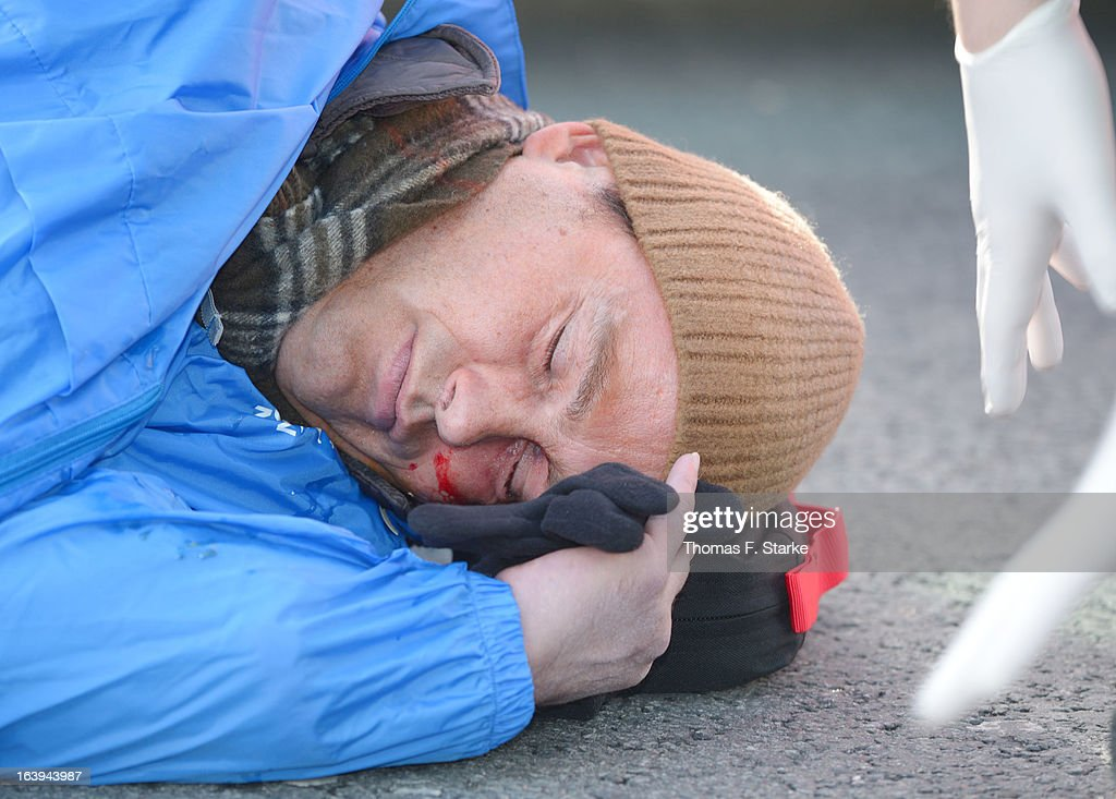Police stand by as Joerg Ueckermann, Deputy Chairman of the anti-Islam Pro-NRW group, lies on the ground after a protester hit him in the face with an egg while Ueckermann was speaking during a Pro-NRW rally on March 18, 2013 in Bielefeld, Germany. Nine Pro-NRW members held the rally and were booed down by 700 counter-demonstrators. Pro-NRW, based primarily in western Germany and Berlin, has sought a strongly anti-Islam agenda and demonstrates frequently against the construction of mosques in Germany. Police recently arrested several radical Salafite Islam members in Germany who were planning to assassinate Pro-NRW leader Markus Beisicht.