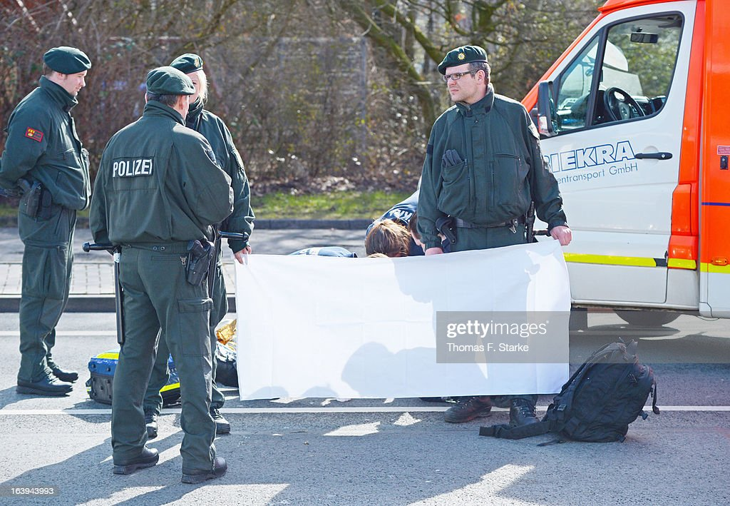 Police stand by as Joerg Ueckermann, Deputy Chairman of the anti-Islam Pro-NRW group, receives medical treatment after a protester hit him in the face with an egg while Ueckermann was speaking during a Pro-NRW rally on March 18, 2013 in Bielefeld, Germany. Nine Pro-NRW members held the rally and were booed down by 700 counter-demonstrators. Pro-NRW, based primarily in western Germany and Berlin, has sought a strongly anti-Islam agenda and demonstrates frequently against the construction of mosques in Germany. Police recently arrested several radical Salafite Islam members in Germany who were planning to assassinate Pro-NRW leader Markus Beisicht.
