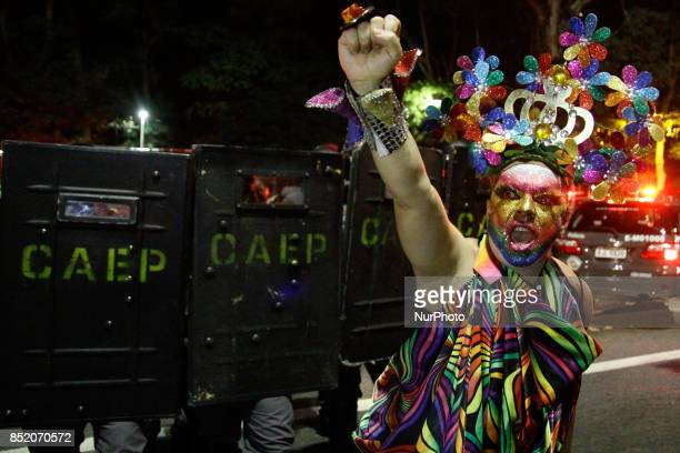 Police stand by as people protest against the decision of a Brazilian judge who approved gay conversion therapy in Sao Paulo Brazil on September 22...