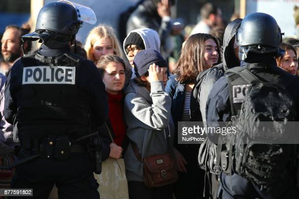 Police stand ground as hundreds march in Paris on November 22 2017 to protest against a reform on university entry requirements French students march...