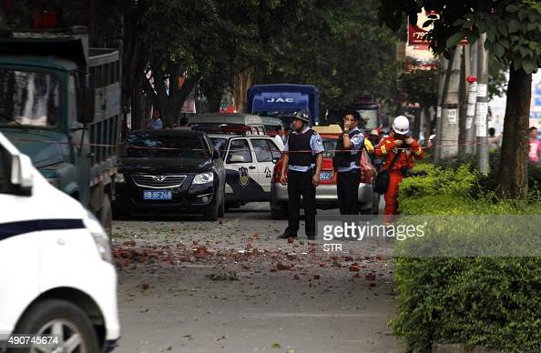 Police stand guard after a blast occurred in the early morning in Liucheng a rural county of the Guangxi region on October 1 one day after 17 parcel...