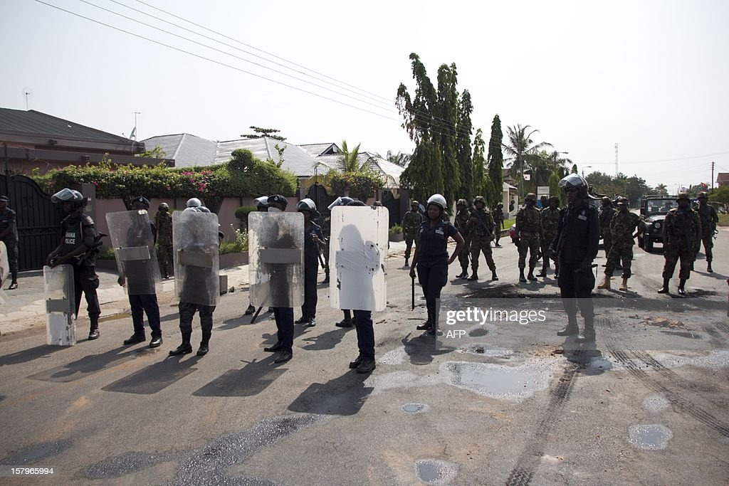 Police stand guard against protesters angry over alleged vote-rigging on December 8, 2012 in Accra.Ghanaian authorities fired tear gas on Saturday to disperse a crowd of more than 100 people in the capital Accra who were angry over rumours of rigging in the country's elections.